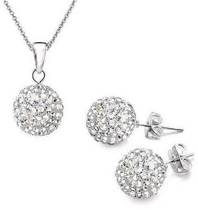 A set of earrings and chains in the form of a metallic mixture and a silver  crystal ball